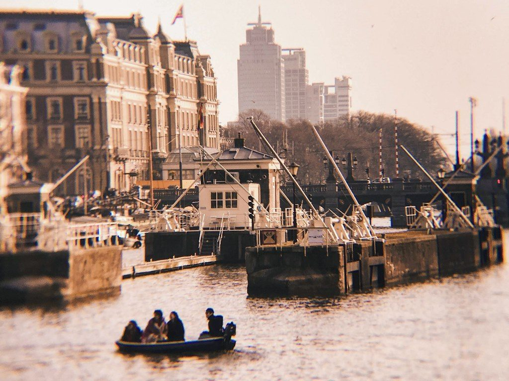 Amstel river in Amsterdam with vintage photo effects