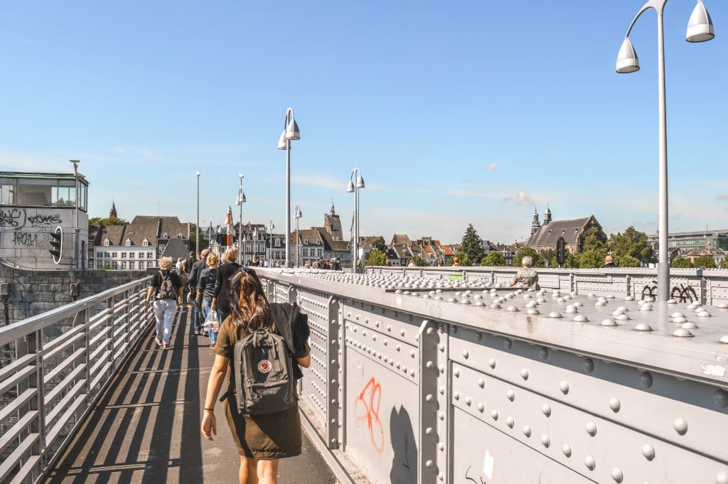 A bridge in Maastricht with several pedestrians crossing