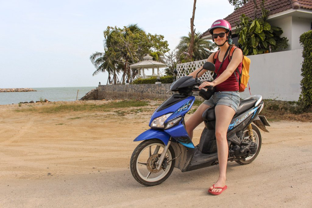 Marijke poses on a scooter in South East Asia