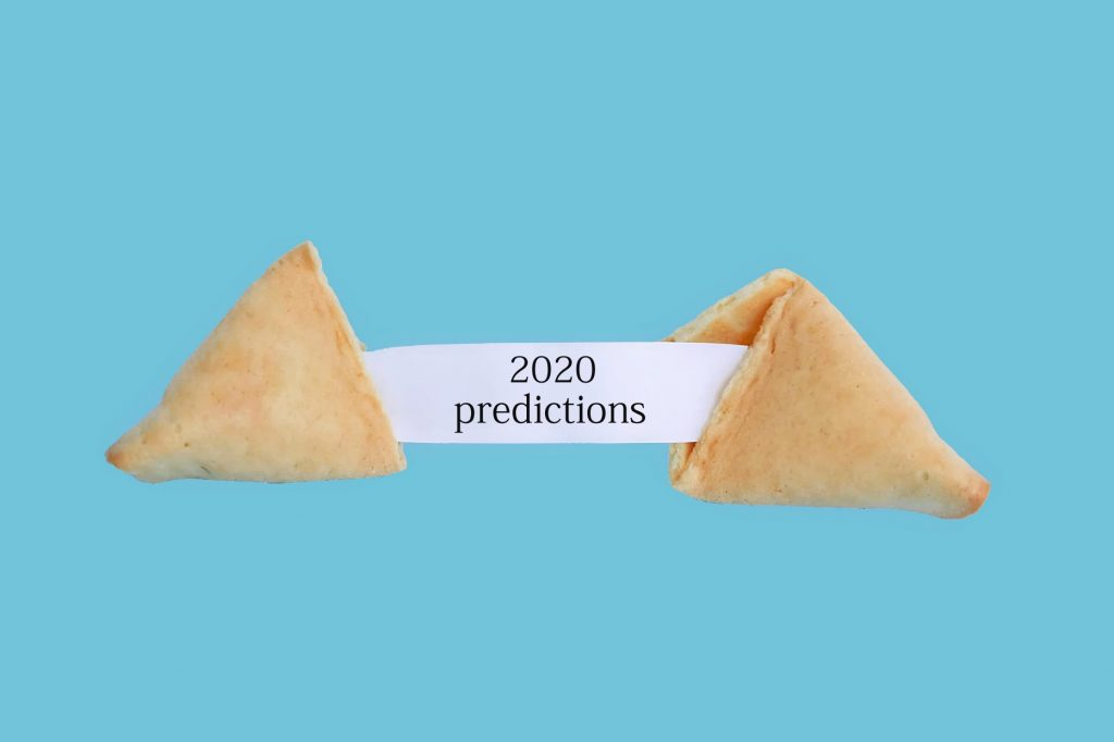 A fortune cookie that reveals a slip of paper with the text: 2020 predictions