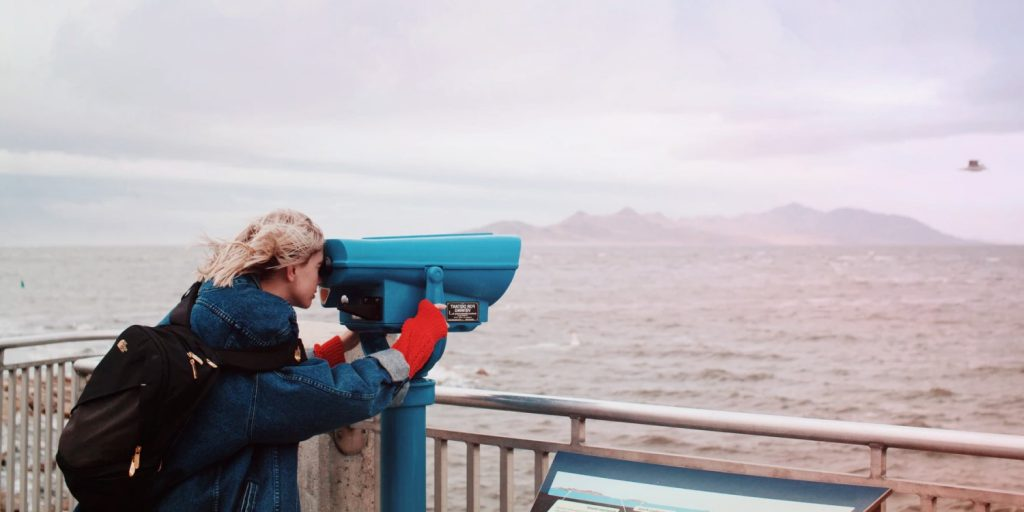 A girl looking through a telescope: We discuss the future of storytelling in six predictions for 2020