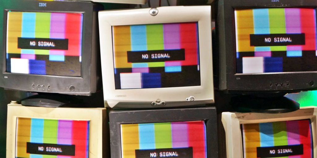 Dealing with information overload: six computer screens from the 90s show a now signal sign